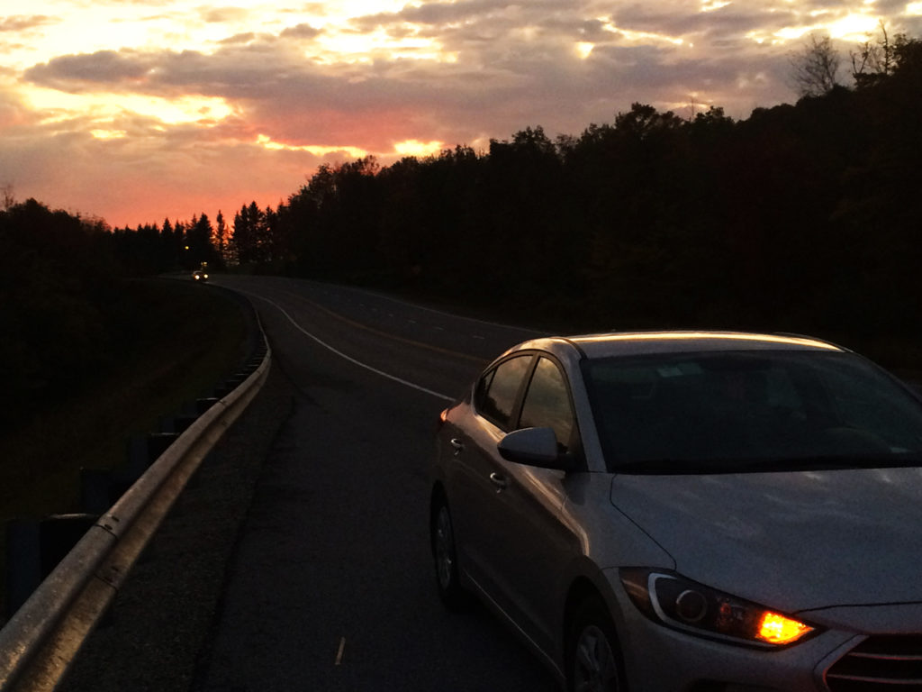 Usa-Road-trip-Car-sunset